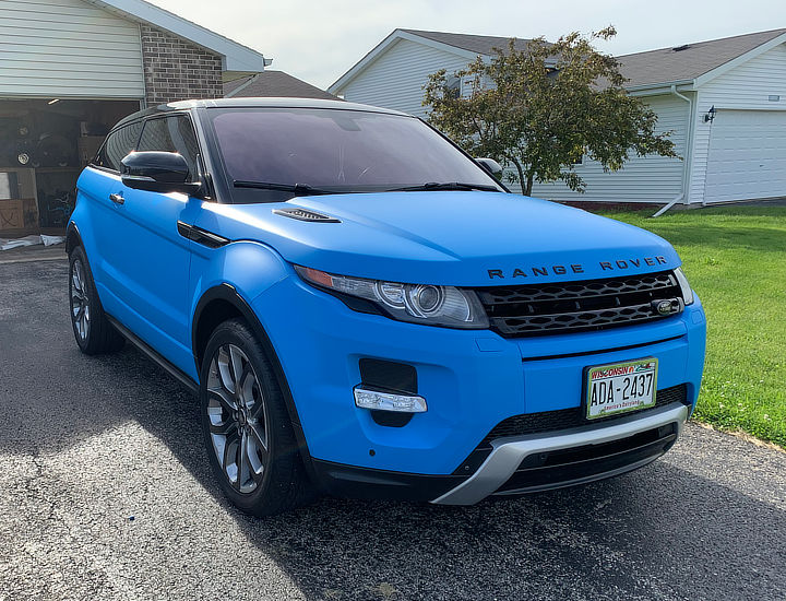 Land Rover in blue car wrap by Crazy Joe's Wraps