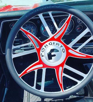 steering wheel in red vinyl wrap - Crazy Joe's Wraps