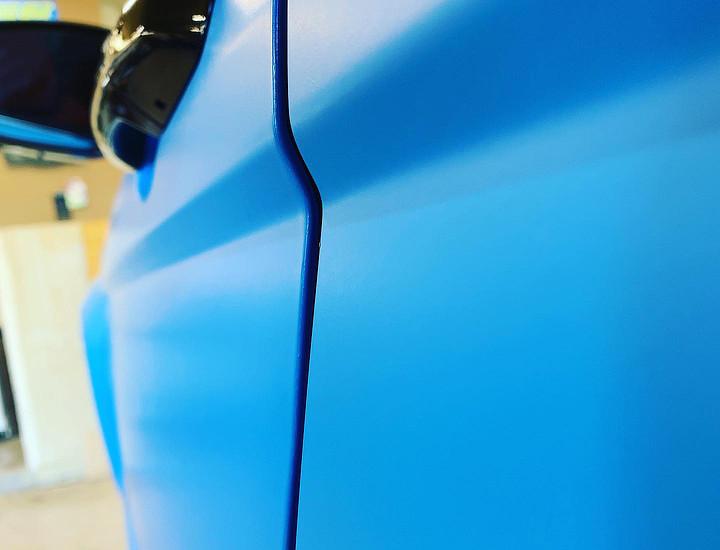 Blue vinyl wrap on truck