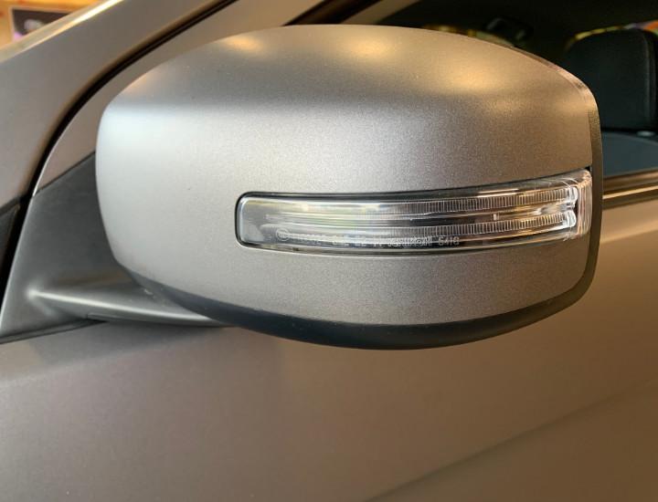 Professional car wrap around a mirror