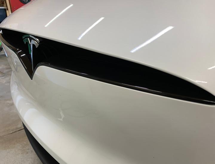 White Tesla Chrome Delete